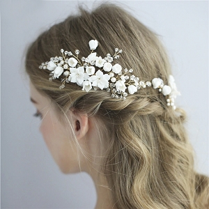 White floral bridal hair comb set made with ceramic flowers with two hair pins